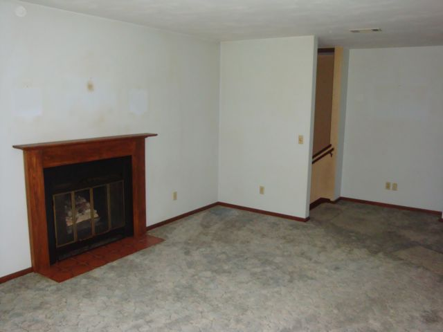 Living room fireplace before
